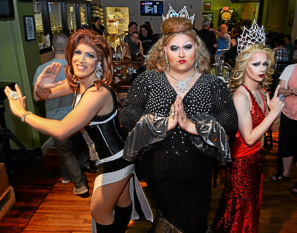 Description of . Drag queens, Katrina Escalarza, Fanci DisMount and Aida Snatchwell pose together after a show at Round Guys Brewing Co. in Lansdale on Saturday June 22, 2014. Photo by Mark C. Psoras/The Reporter