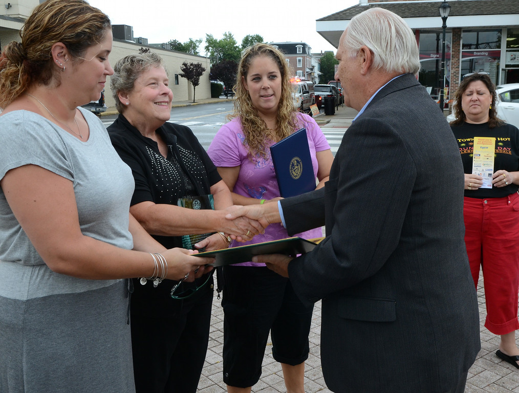 Description of . Senator Bob Mensch hands a proclamation to Dorothy Frederick (2nd from L) and her daughters Stephanie (L) and Karen Diehl after the the Lansdale Borough Lifetime Achievement Award was presented to the late Stephen Frederick  during the Lansdale Founders Day  celebration and on Saturday August 23,2014. Photo by Mark C Psoras/The Reporter