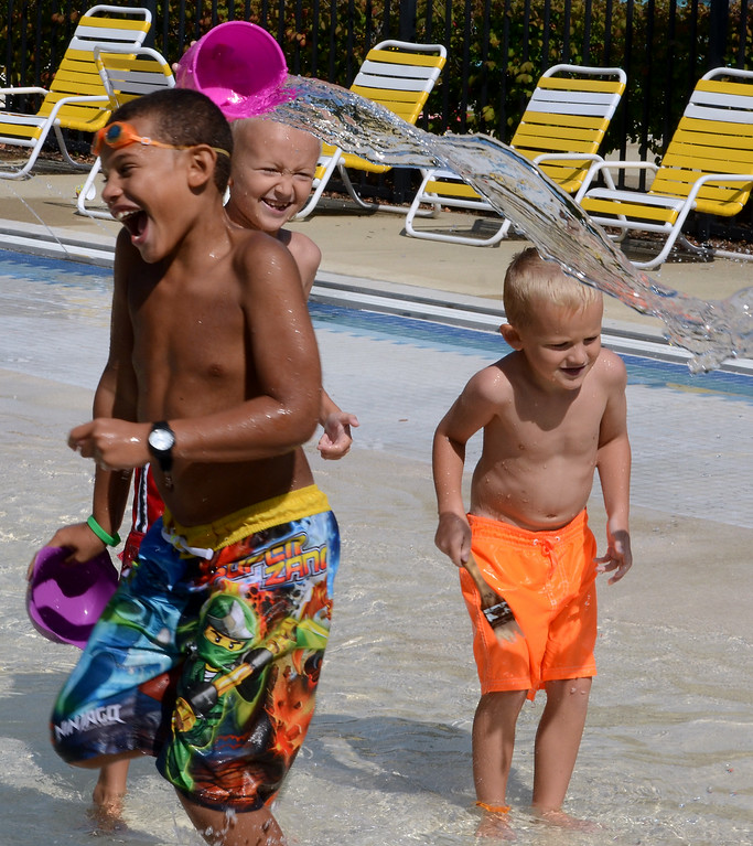 Description of . Anthony Hall (L) and brothers Aidan (center) and Aren Ashley play at the Fourth Street Pool in Lansdale as they cool off on a hot and sunny Tuesday afternoon August 26,2014. Photo by Mark C Psoras