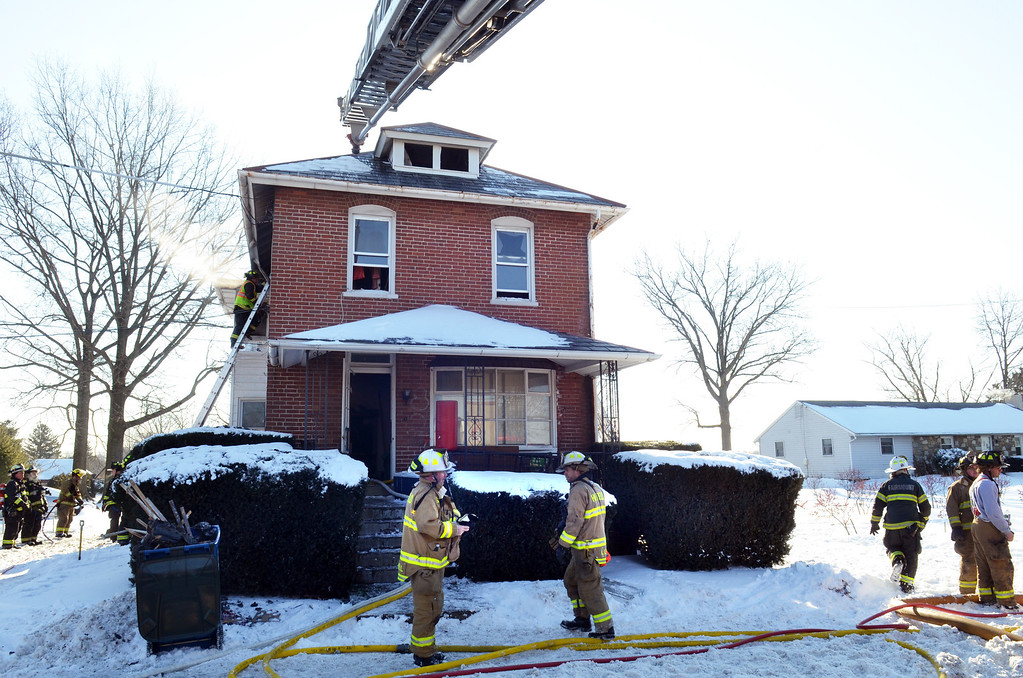 Description of . Firefighters at scene of house fire on Forty Foot Road in Hatfield Township.   Thursday, Janury 23, 2014.  Photo by Geoff Patton