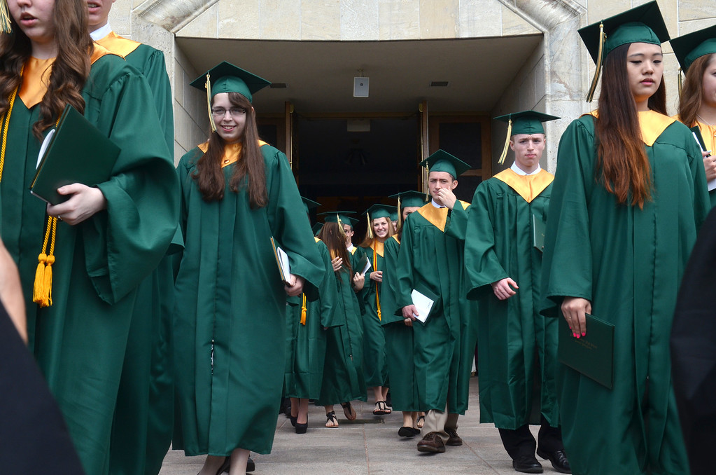 Description of . Lansdale Catholic high school graduates walk toward the stairs at  the Shrine of Czestochowa following commencement ceremony.  Tuesday, June 3, 2014.  Photo by Geoff Patton