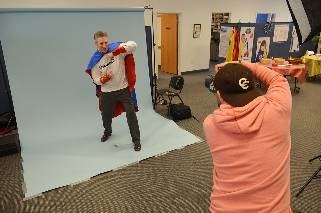 Description of . Photographer Marco Calderon at work with State Representative Todd Stephens  during a shoot for the North Penn United Way's third annual Superheroes United for Kids event.   Finished photographs are used in promotion and will be  displayed during the event in April.   Friday, January 24, 2014.  Photo by Geoff Patton