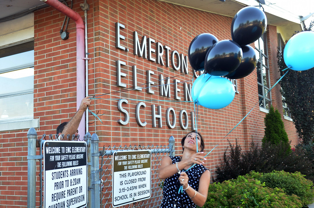 Description of . Principal Tamara Callahan sets up balloons on first day of school at EM Crouthamel Elementary in Souderton.   Monday, August 25, 2014.  Photo by Geoff Patton