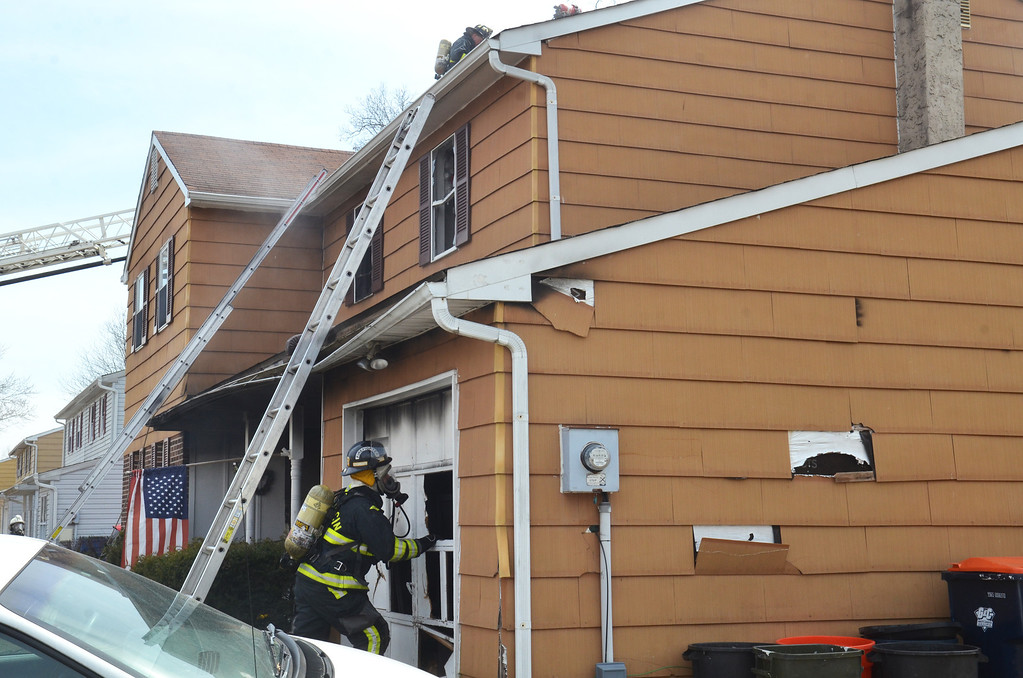Description of . House fire on Adams Avenue in Hatfield Township.  Thursday, March 27, 2014.  Photo by Geoff Patton