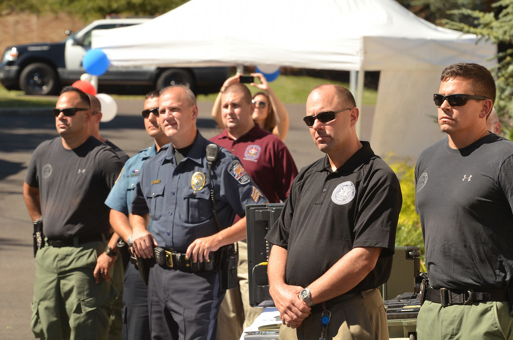 Description of . Membes of the law enforcement community listen during a ceremony at WM Robots LLC in Colmar.   The company donated a robot to the Montgomery County District Attorney's office.     Thursday, August 28, 2014.  Photo by Geoff Patton