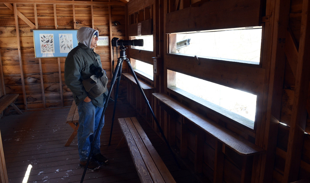 Description of . Bill Moses of Norristown waits for a photo opportunity in the bird blind at Peace Valley Nature Center in New Britain Township.    Wednesday,  January 29, 2014.   Photo by Geoff Patton