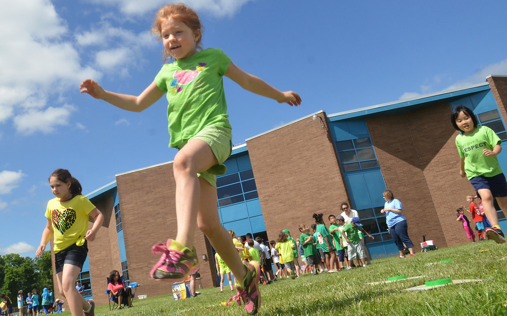 Description of . Second grader Cadence Arroyo competes in a game during   Olympics Day at Hatfield Elementary School.   Friday,  June 6, 2014.   Photo by Geoff Patton