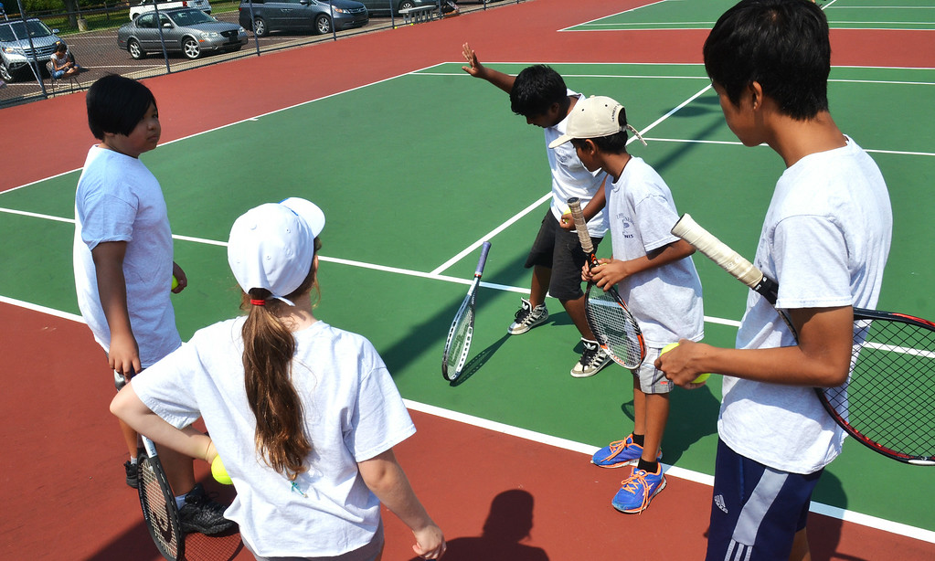 Description of . Players determing starting court position during the UG Open Teen Tennis Tournament in Upper Gwynedd.    Friday,  August 8, 2014.   Photo by Geoff Patton