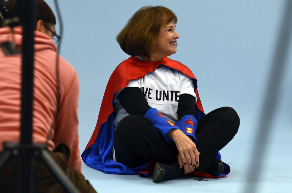 Description of . Debbie  Levin smiles during a shoot for the North Penn United Way's third annual Superheroes United for Kids event.   Finished photographs are used in promotion and will be  displayed during the event in April.   Friday, January 24, 2014.  Photo by Geoff Patton
