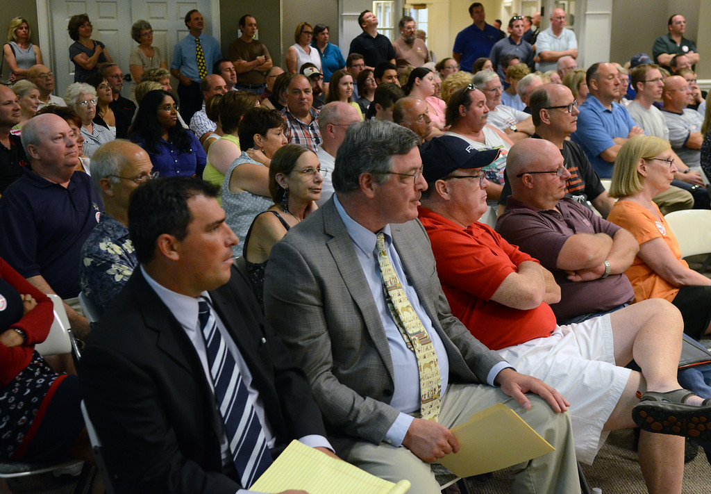 Description of . A large group of Hatfield Township residents pack the township building for a meeting regarding a Montgomery Township based ministry Keystone Fellowship that is seeking to build a church on Orvilla Road. Wednesday august 27,2014. Photo by Mark C Psoras/The Reporter