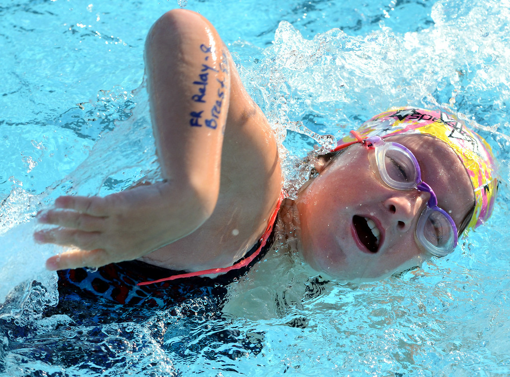 Description of . Hatfield swimmer Heather Sisian ,7, competes in a free relay event during the teams meet against Harleysville at the Harleysville Community Pool on Thursday July 17,2014.Photo by Mark C Psoras/The Reporter