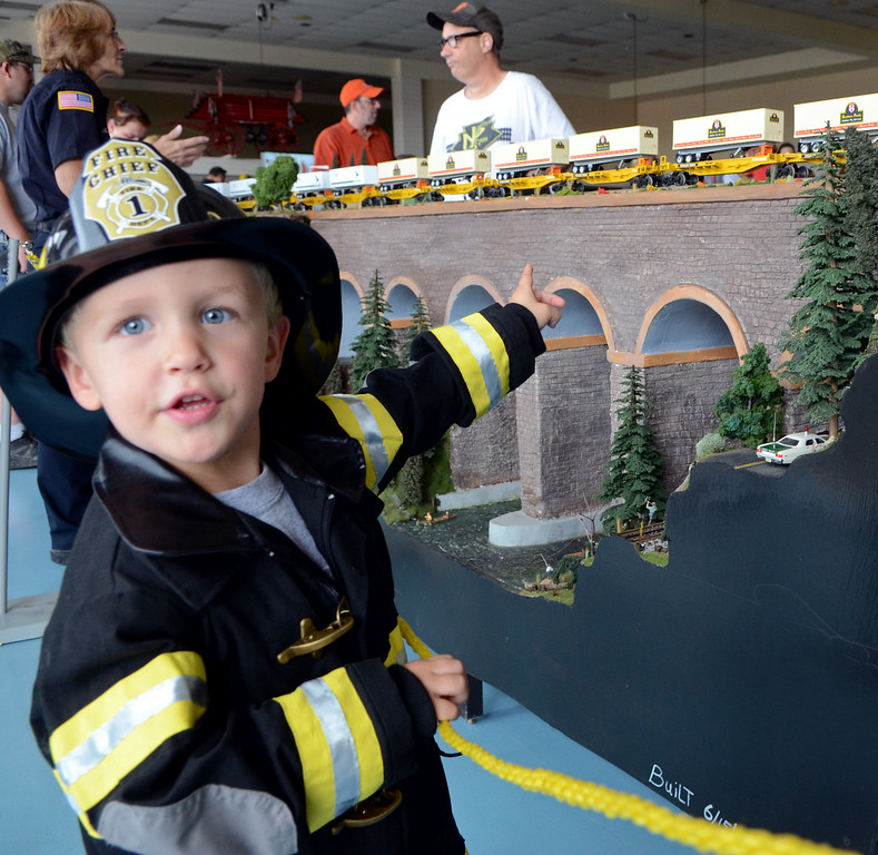 Description of . Camryn Fickert ,3, checks out a model train display by the North Penn 'O' Guagers at an open house of the Fairmount Fire Company during the Lansdale Founders Day  celebration on Saturday August 23,2014. Photo by Mark C Psoras/The Reporter