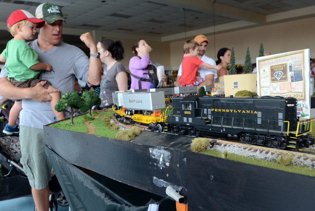 Description of . A model train display is checked out at an open house of the Fairmount Fire Company during the Lansdale Founders Day  celebration on Saturday August 23,2014. Photo by Mark C Psoras/The Reporter