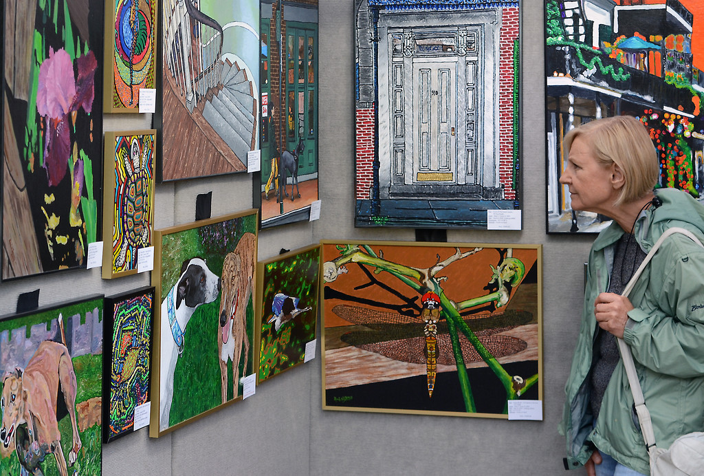 Description of . Works by artist Mark V Turner are inspected during the 26th Annual Lansdale Festival of the Arts in Memorial Park on Saturday August 23,2014. Photo by Mark C Psoras/The Reporter