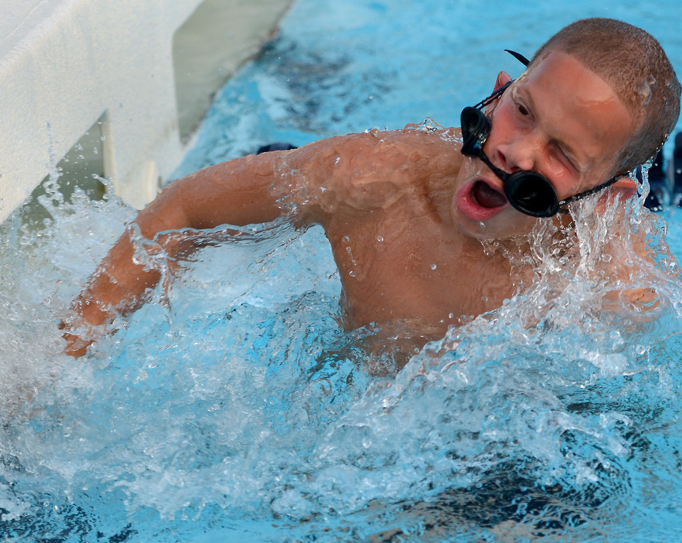 Description of . A swimmer loses his googles as Hatfield and Nor Gwyn boys 8 and under compete in a butterfly event during their Bux Mont swim Meet at the Hatfield Aquatic Center  on Tuesday July 22,2014.Photo by Mark C Psoras/The Reporter