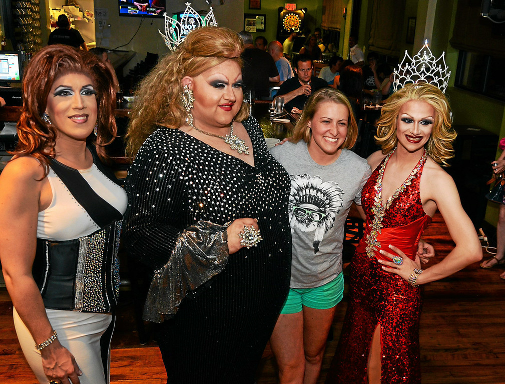 Description of . Katrina Escalarza, from left, Fanci DisMount and Aida Snatchwell, at right, pose together with an audience member after a show at Round Guys Brewing Co. in Lansdale on Saturday June 22, 2014. Photo by Mark C. Psoras/The Reporter