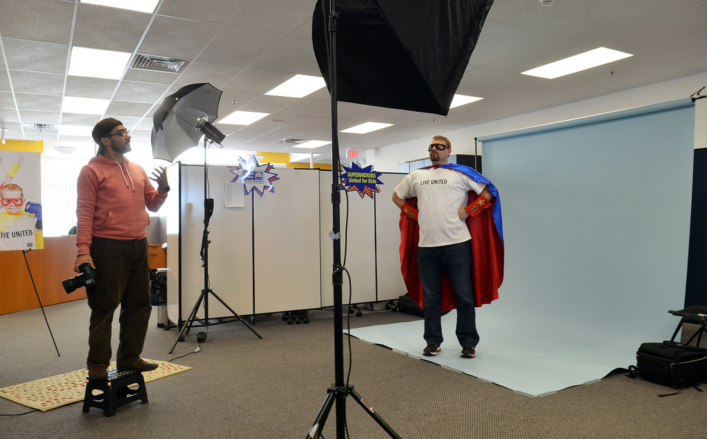 Description of . Josh Rennels  Clemens Family Corporation takes directin ffrom photographer Marco Calderon  during a shoot for the North Penn United Way's third annual Superheroes United for Kids event.   Finished photographs are used in promotion and will be  displayed during the event in April.   Friday, January 24, 2014.  Photo by Geoff Patton