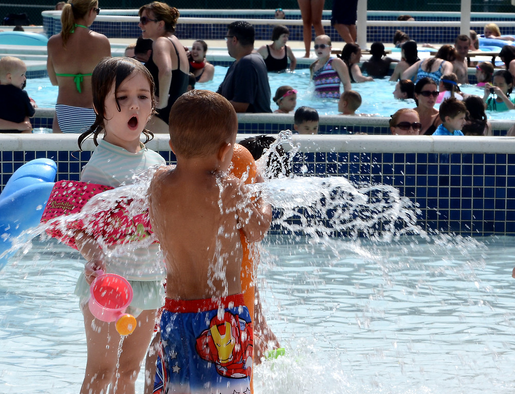 Description of . A packed crowd cools off at the Hatfield Aquatic Center on a hot and steamy Wednesday July 23,2014. Photo by Mark C Psoras/The Reporter