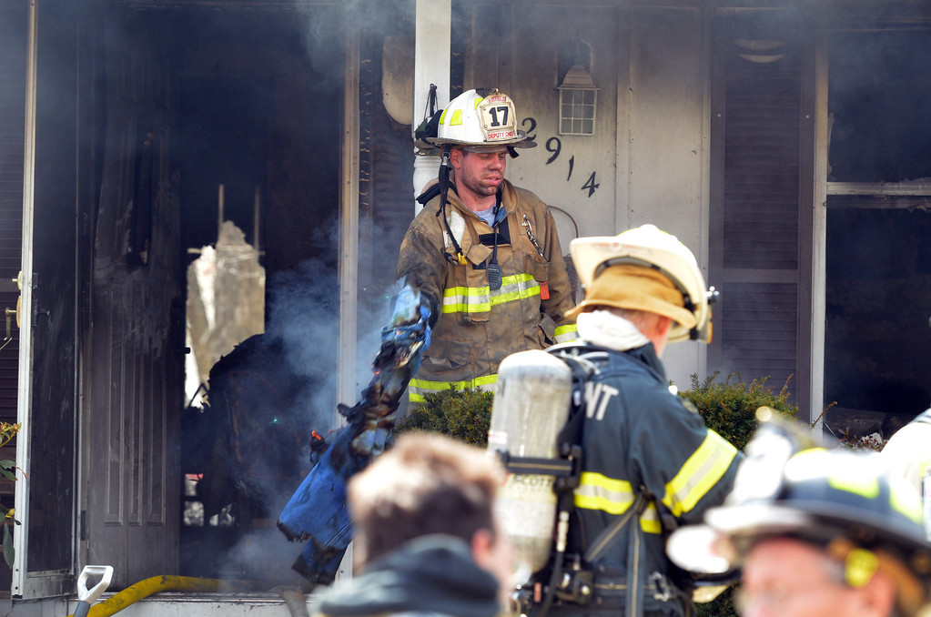 Description of . Hatfield chief Andrew Lersch  at house fire on Adams Avenue in Hatfield Township.  Thursday, March 27, 2014.  Photo by Geoff Patton