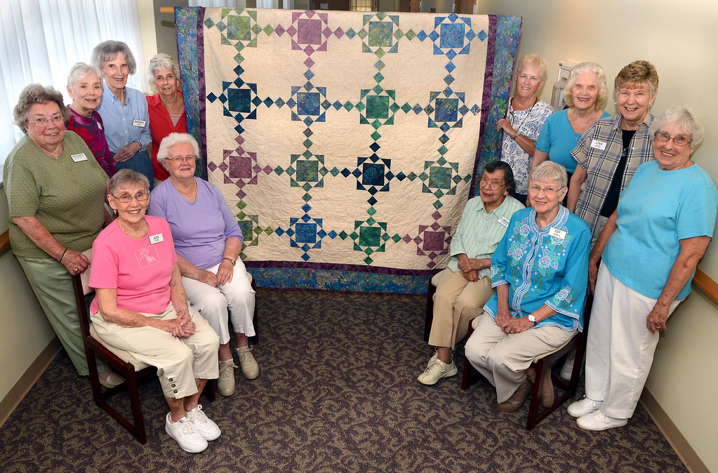 Description of . Brittany Pointe Quilters (L-R top)Rosemary Dougherty,Nora O'Malley,Barbara Kerr,Jennie Barratt,Virginia Altman,Lois Burns,Lynn Nurse and Pat Wilson, (L-R seated)Jean Shaw,Helen Lindquist,Florence Johnson and Edy Koenig with the quilt they made for the raffel in November . Photo by Mark C Psoras/The Reporter