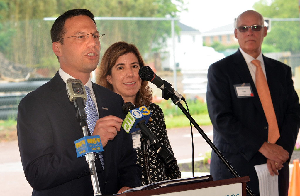 Description of . Montgomery County Commissioners chairman Josh Shapiro, left, speaks the North Penn Commons groundbreaking in Lansdale.  At center Montgomery County Commissioner Leslie Richards and at right is   Russell Johnson, President and CEO, North Penn Community Health Foundation.    Tuesday, June 10, 2014.   Photo by Geoff Patton