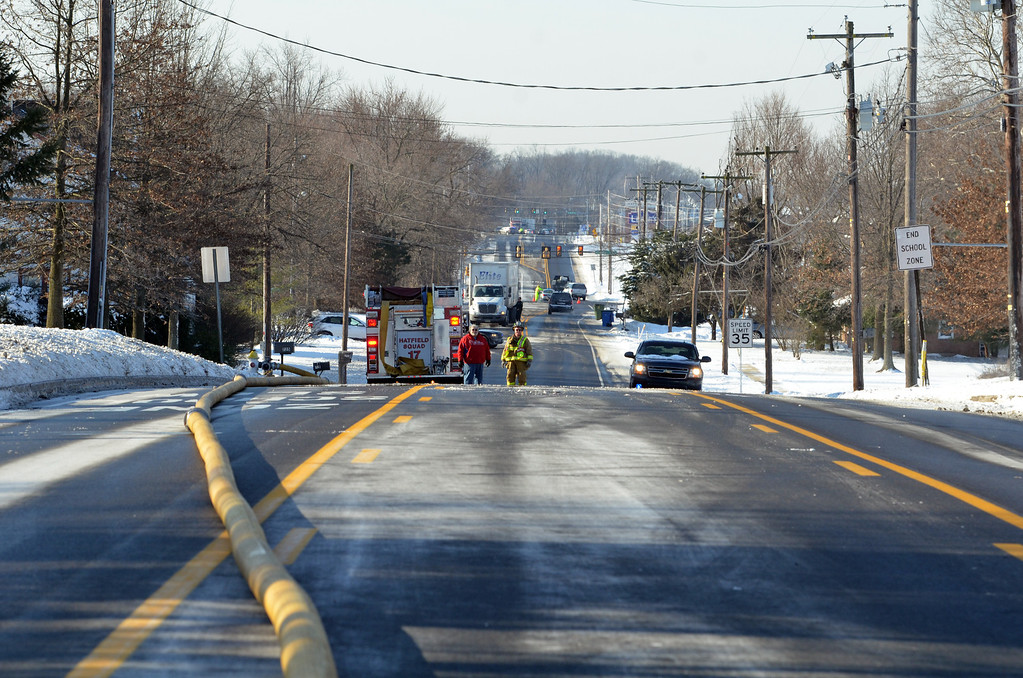 Description of . Forty Foot Road in Hatfield Township, closed to traffic during  fire department activity .    Thursday, ,January 23, 2014.   Photo by Geoff Patton