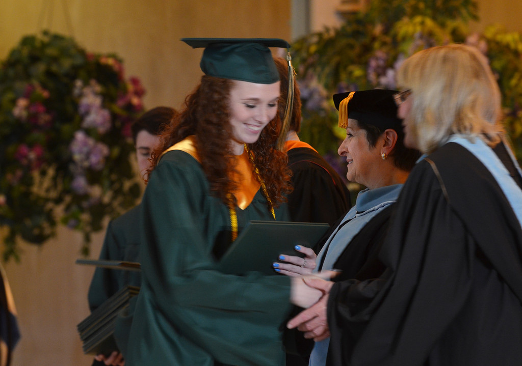 Description of . Molly Ann Caruso receives her diploma at the Lansdale Catholic high school commencement ceremony.   Tuesday, June 3, 2014.  Photo by Geoff Patton