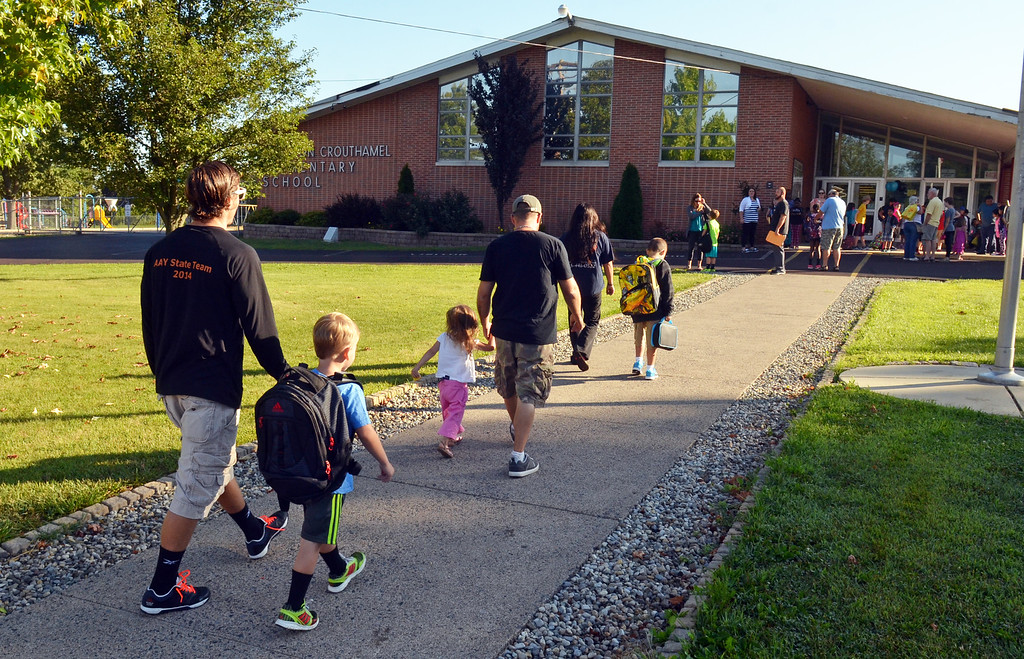 Description of . Students with parents head for the entrance of EM Crouthamel Elementary School in Souderton on the first day of school.   Monday, August 25, 2014.   Photo by Geoff Patton
