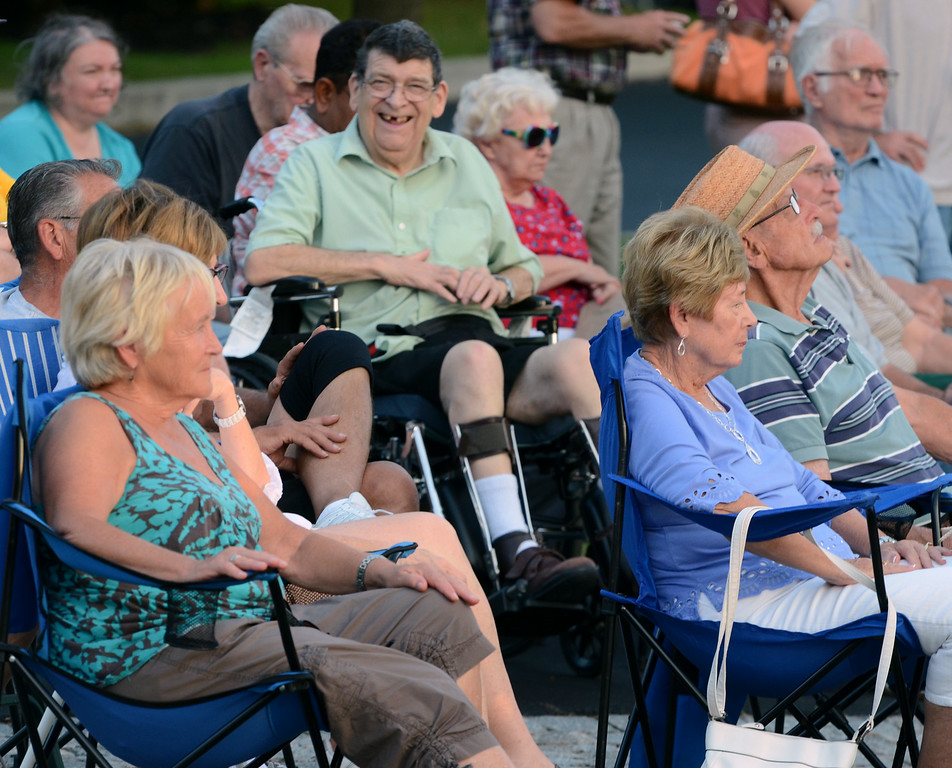 Description of . Audience members listen as musician Bobby Jo Valentine performs an outdoor concert on the front steps of Trinity Lutheran Church in Lansdale  on Wednesday evening August 27,2014. Photo by Mark C Psoras/The Reporter