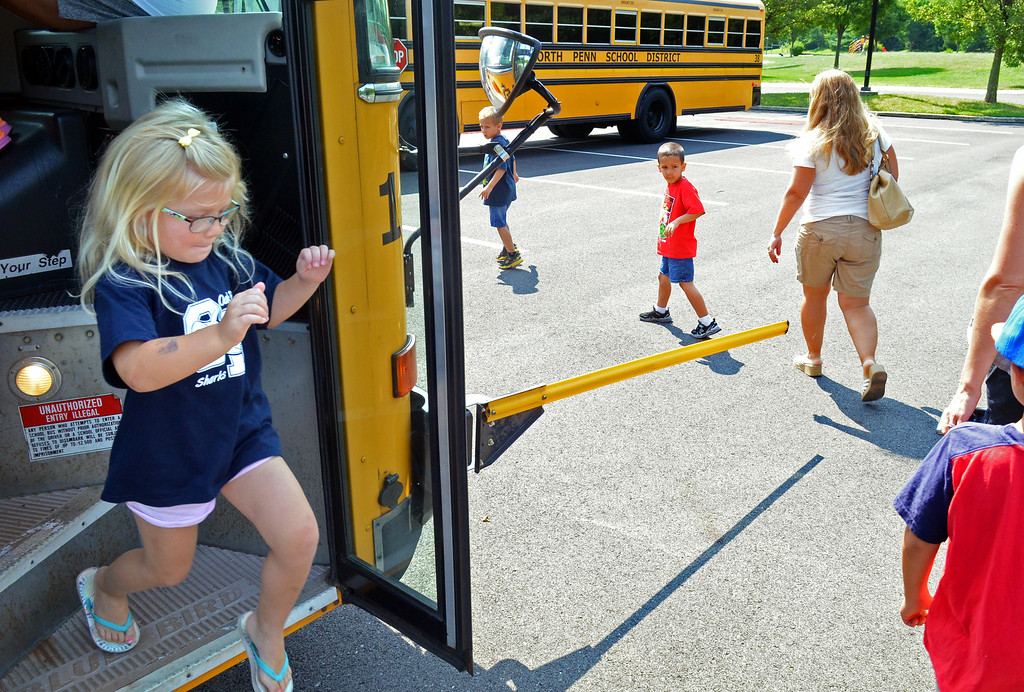 Description of . Walton Farm Elementary School hosted K-Day, an opportunity for kindergartners to become familiar with  how to safely board and  ride on a school bus.    Thursday,  August 7, 2014.   Photo by Geoff Patton