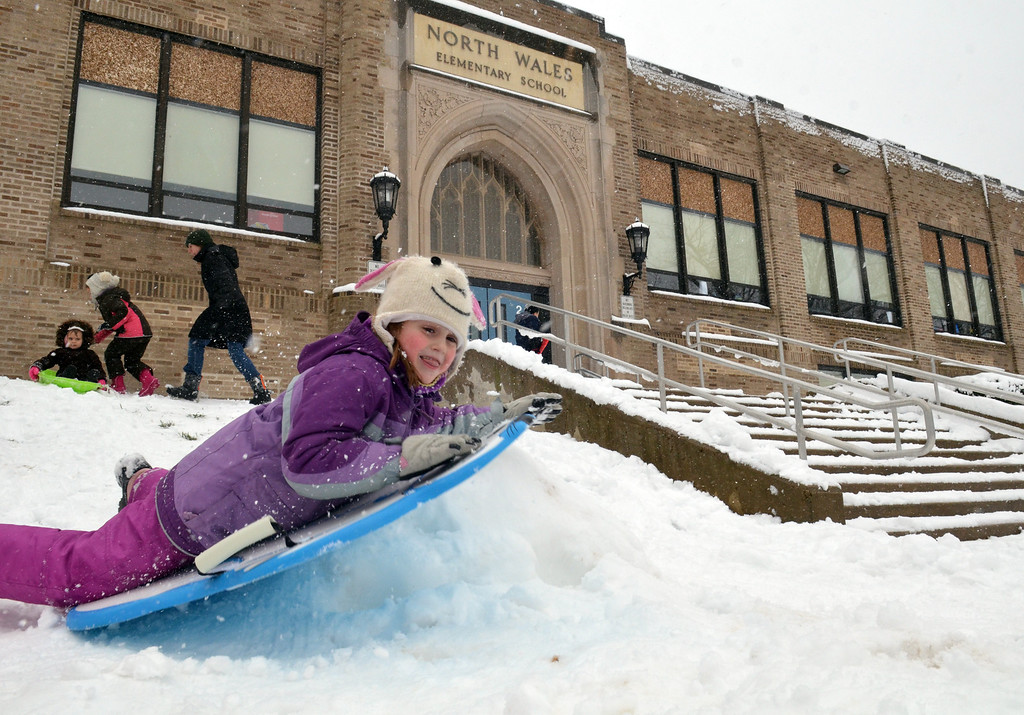 Description of . Nora Keller, who attends kindergarden at North Wales elementary school, enjoys playing in the snow on a day the school was closed due to storm.   (The Reporter/Geoff Patton)