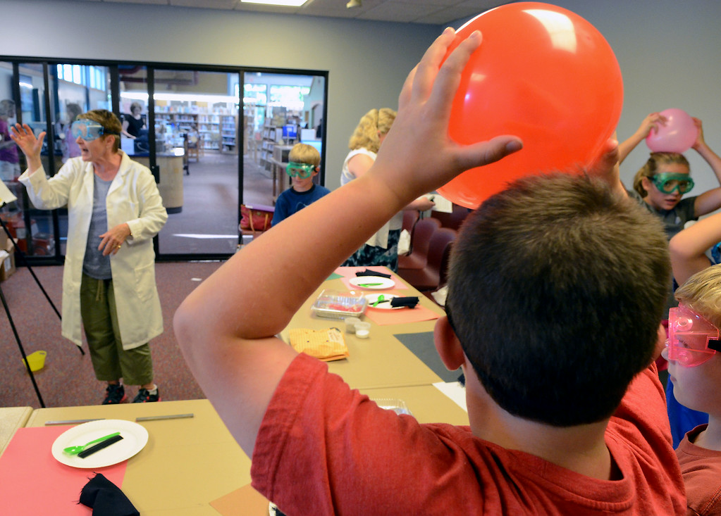Description of . Teacher Rosemary Carr leads children in experiments in Physical Science & Eelectricity during the GSK Science in Summer event at the Perkasie Branch of the Free Library of Bucks County on Tuesday July 22,2014.Photo by Mark C Psoras/The Reporter