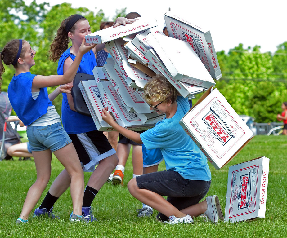Description of . Boxes tumble as sixth graders compete in the pizza relay during Olympics Day at Hatfield elementary school.   Friday, June 6, 2014.   Photo by Geoff Patton