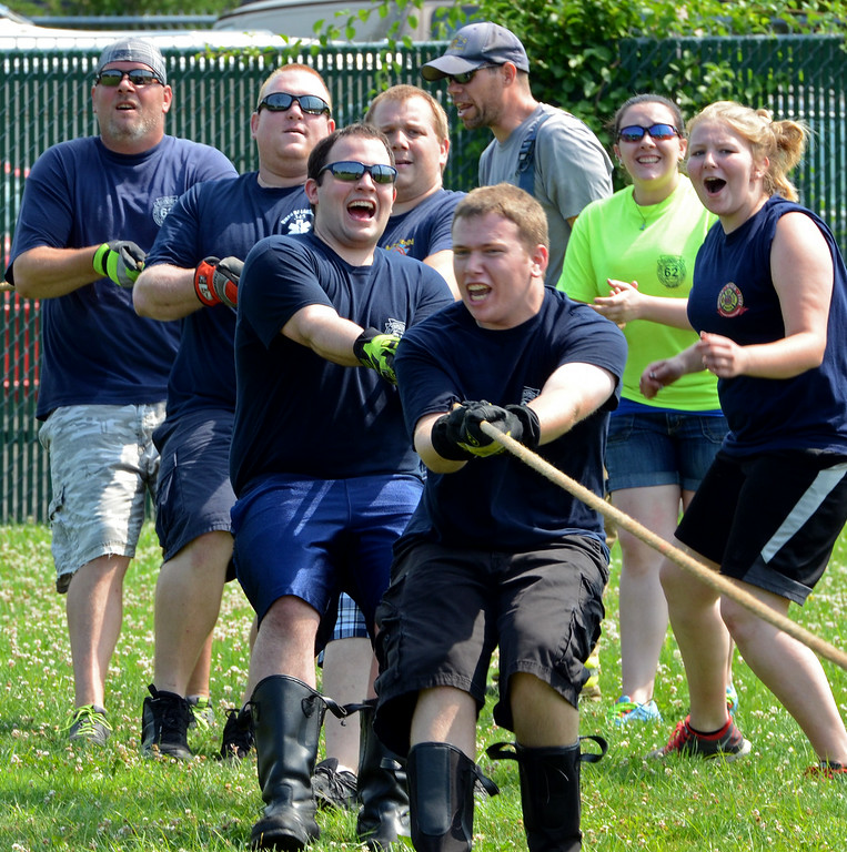 . North Penn  Fire Company members take part in a tug-of-war competition during the 14th annual Montgomery County Fifth Fire District Water Battle held at the Towamencin Firehouse on Saturday morning July 12,2014.Photo by Mark C Psoras/The Reporter