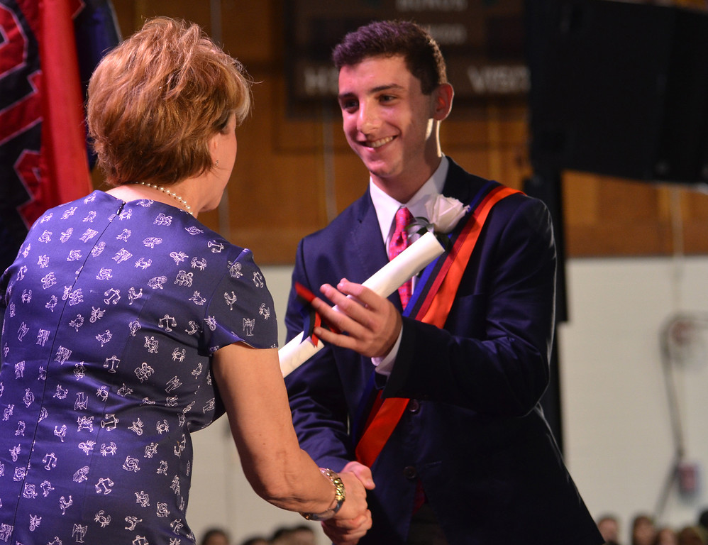 . Germantown Academy graduate Maxwell Detweiler receives diploma from Judi J. Goodman, President, Board of Trustees.   Friday,  June 13, 2014.   Photo by Geoff Patton