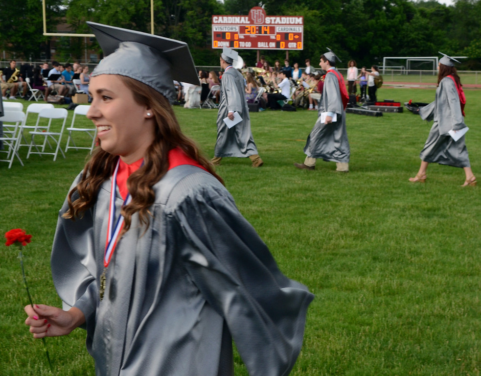 . Upper Dublin High School Class of 2014 members march onto the stadium field for their Commencement Ceremony at the school on Tuesday evening June 10,2014. Photo by Mark C Psoras/The Reporter