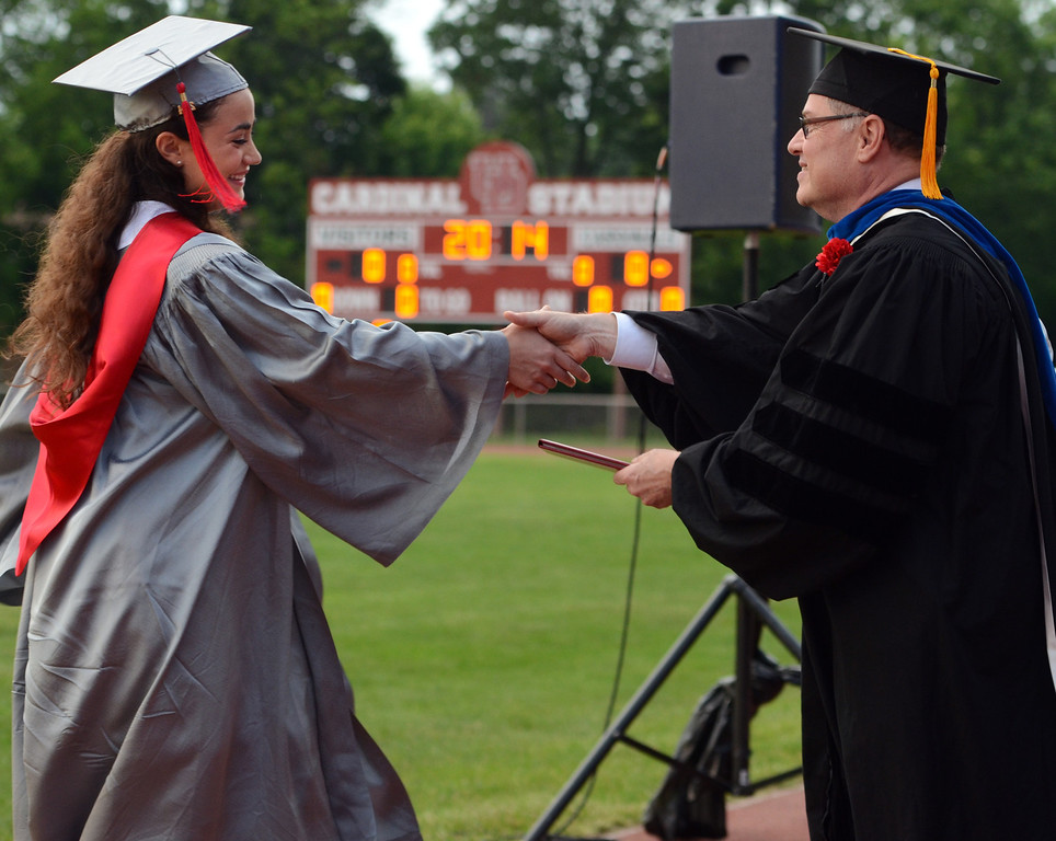 . Upper Dublin High School Class of 2014 members recieve their diplomas during their Commencement Ceremony at the school on Tuesday evening June 10,2014. Photo by Mark C Psoras/The Reporter