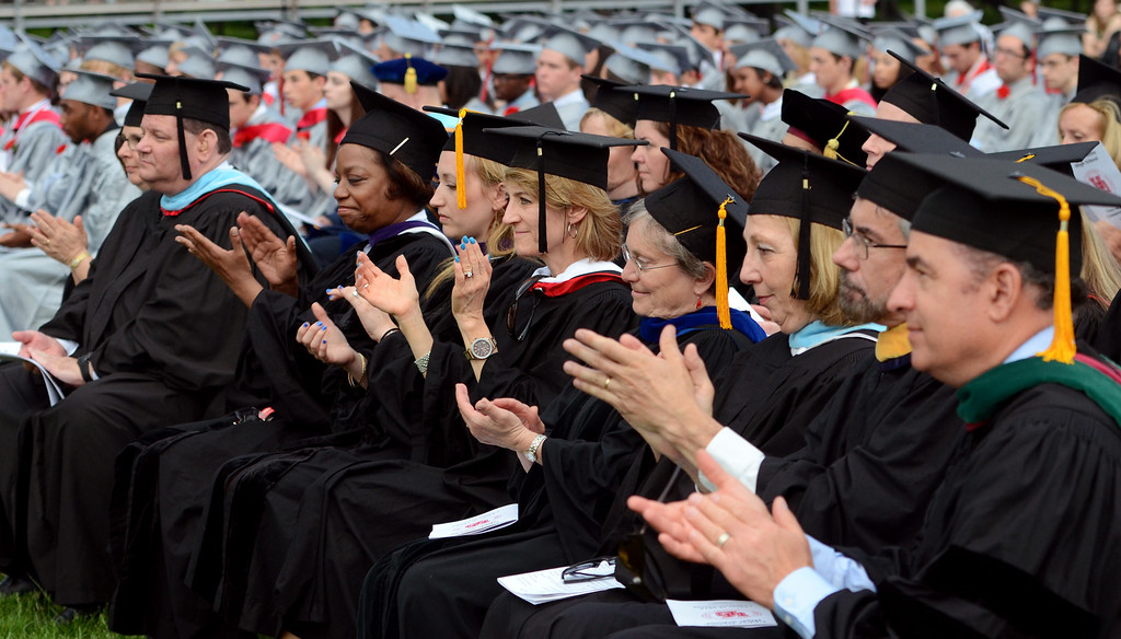 . Upper Dublin High School Faculty and Board members applaud the Class of 2014  during their Commencement Ceremony at the school on Tuesday evening June 10,2014. Photo by Mark C Psoras/The Reporter