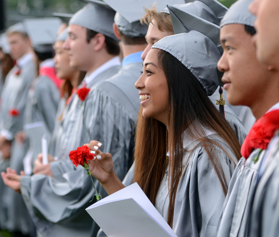 . Upper Dublin High School Class of 2014 members are applauded as they march into the stadium for their Commencement Ceremony at the school on Tuesday evening June 10,2014. Photo by Mark C Psoras/The Reporter