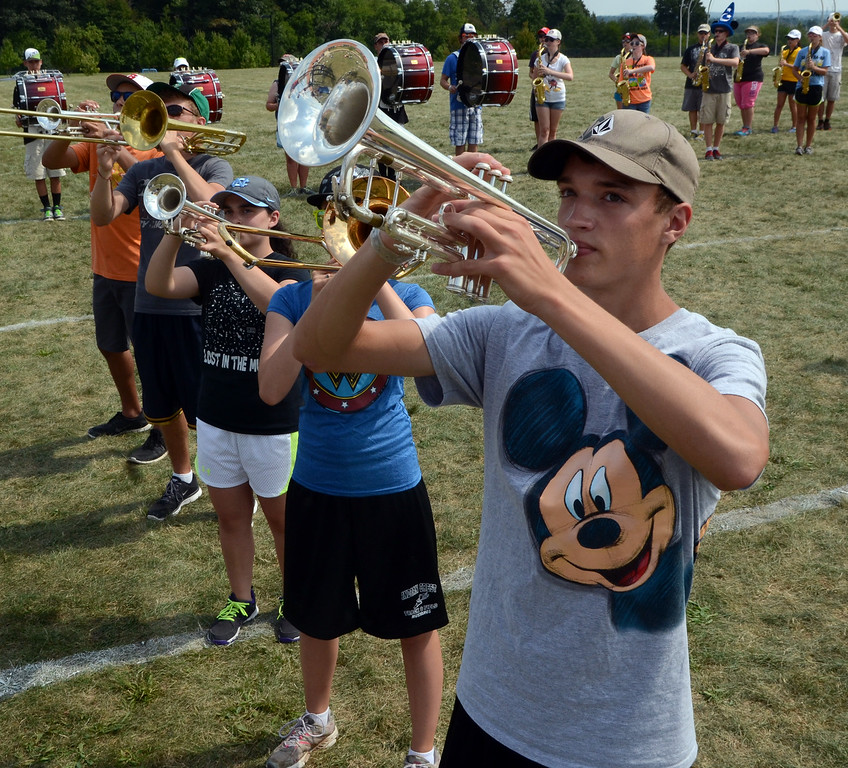 . The Souderton Area High School Big Red Marching Band rehearse during band camp at the school on Tuesday afternon August 19,2014. Photo by Mark C Psoras/The Reporter