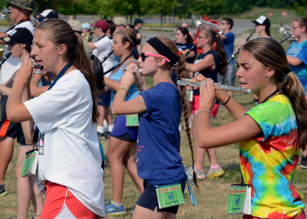 . The North Penn High School Marching Knights rehearse during band camp at the school  on Tuesday afternon August 19,2014. Photo by Mark C Psoras/The Reporter
