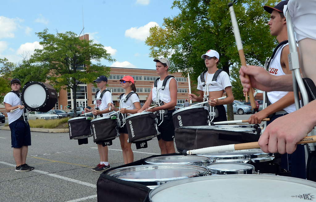 . The North Penn High School Marching Knights percussion section rehearses during band camp at the school  on Tuesday afternon August 19,2014. Photo by Mark C Psoras/The Reporter