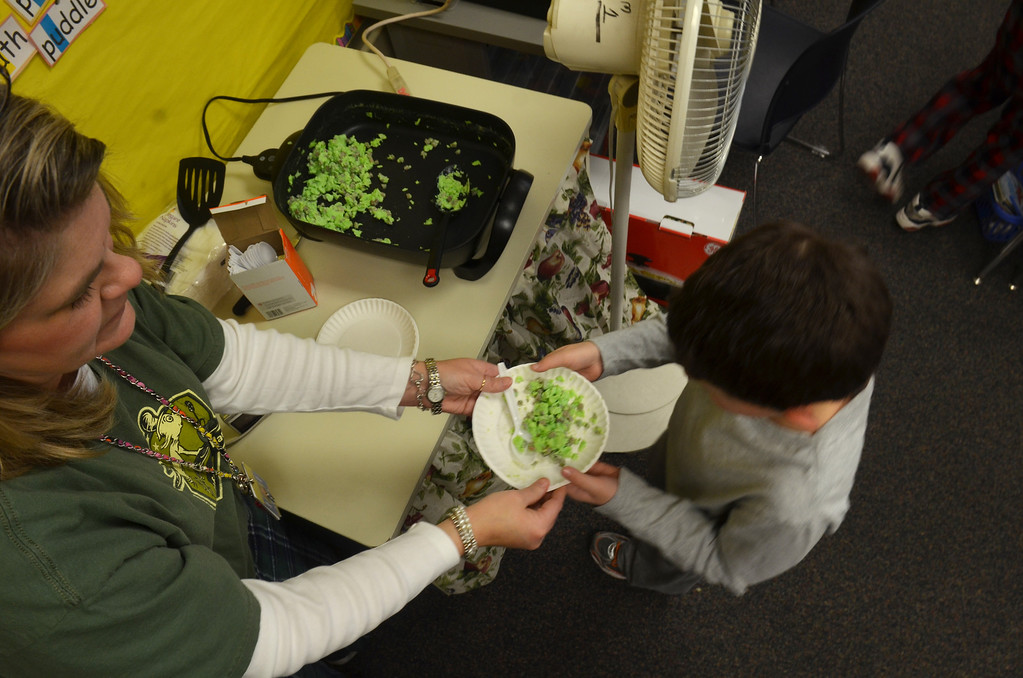 . First grade teacher Angie Bell serves green eggs and ham to her students at Montgomery Elementary School.   Friday, march 7, 2014.  Photo by Geoff Patton