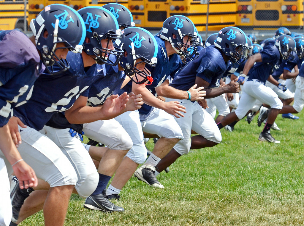 . North Penn High School players at morning practice.   Monday, August 11, 2014.   Photo by Geoff Patton