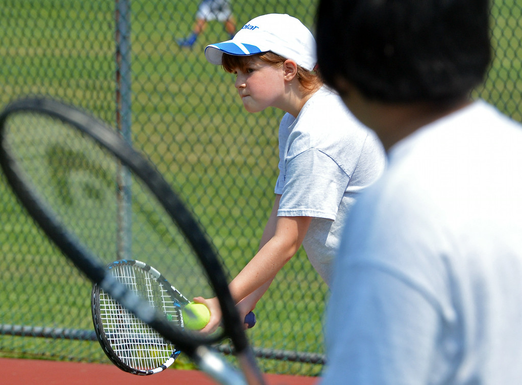 . Sophia Lin gets ready to serve during a doubles match at the UG Open Teen Tennis Tournament in Upper Gwynedd.  At right is Marc Orong.       Friday,  August 8, 2014.   Photo by Geoff Patton