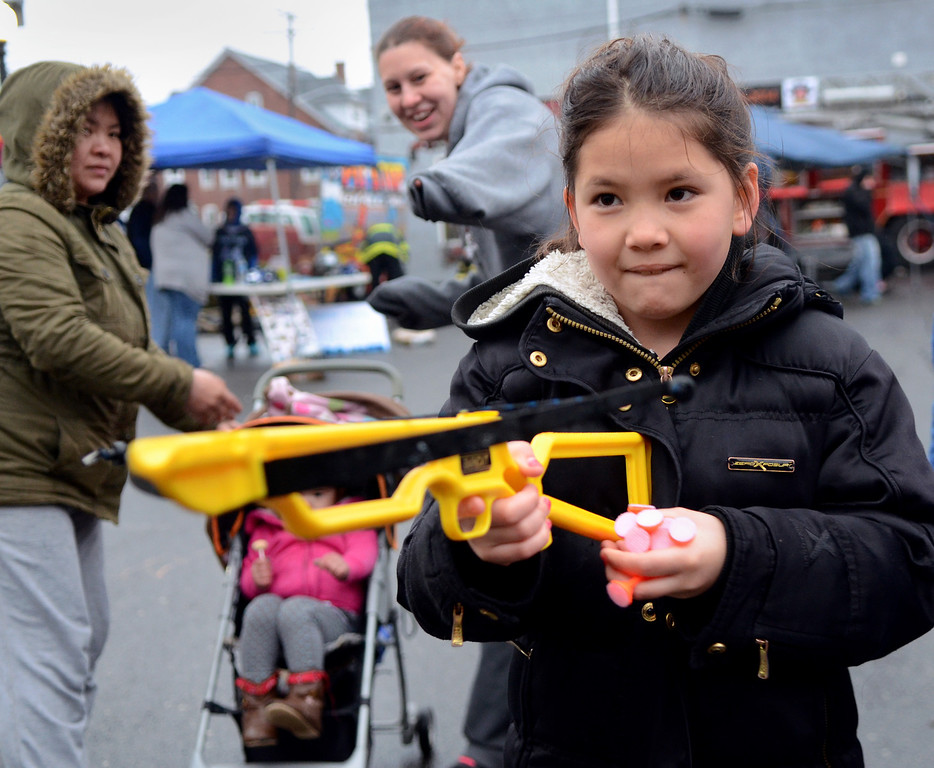. Adelina Wampold along with family members and other children games and activities during First  Fridayevents in Lansdale on a chilly and wet evening  April 4,2014. (The Reporter/Mark C. Psoras)