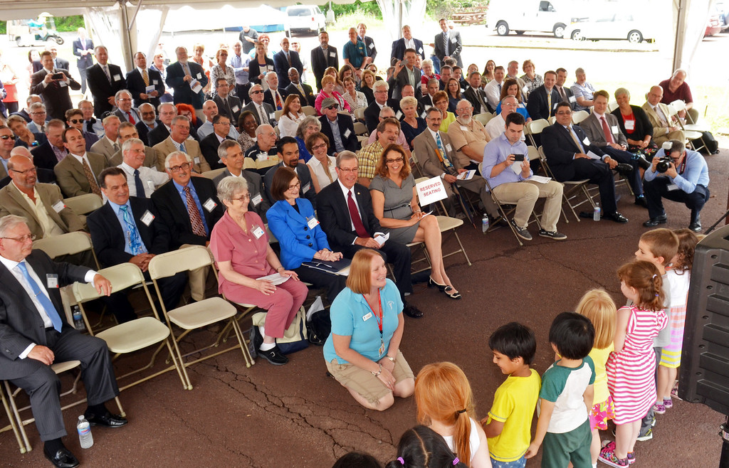 . Pre kindergartners from the Lansdale Branch of th eYMCA sing a song for officials and guests gathered for the groundbreaking of the North Penn Commons in Lansdale.   Tuesday, June 10, 2014.   Photo by Geoff Patton