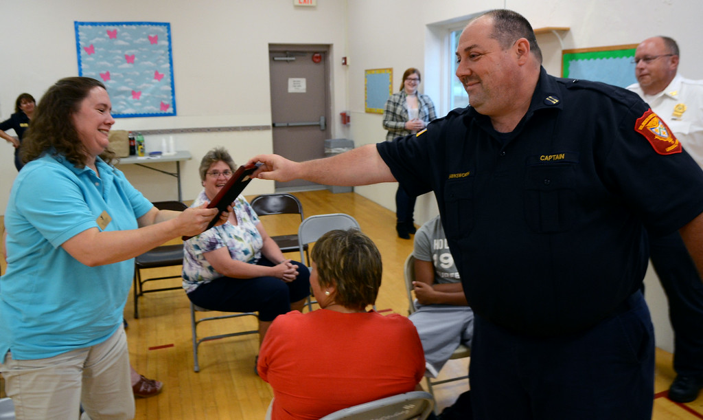 ". Volunteer Medical Service Corps of Lansdale Captain John Hanksworth present a ""Life Saving Recognition Award to North Penn YMCA Aquatics Director Amy Simonds and staff for their recent emergency medical response to an incident at the YMCA. Thursday August 21,2014. Photo by Mark C Psoras/The Reporter"