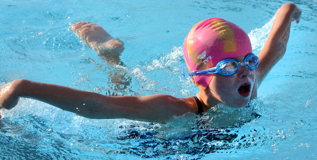 . Harleysville swimmerCameron Mondor,8,  competes in a butterfly event during the teams meet against Hatfield at the Harleysville Community Pool on Thursday July 17,2014.Photo by Mark C Psoras/The Reporter