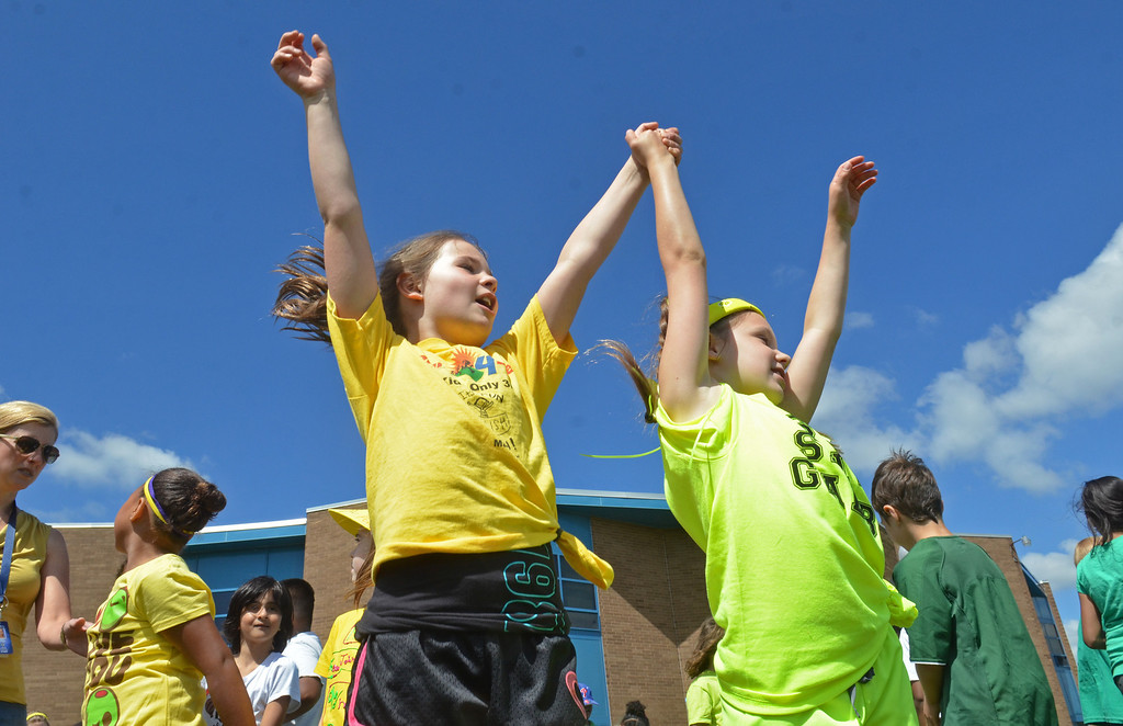 . Second grade girls cheer for the yellow team during Olympics Day at Hatfield Elementary School.   Friday,  June 6, 2014.   Photo by Geoff Patton